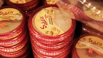 NEW YORK, NY - APRIL 09:  Cases of Sabra Classic Hummus are viewed on the shelf of a grocery store on April 9, 2015 in New York City. Sabra Dipping Co. is recalling 30,000 cases of hummus due to possible contamination with Listeria, the U.S. Food and Drug Administration said Wednesday.  (Photo by Spencer Platt/Getty Images)