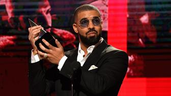 LOS ANGELES, CA - NOVEMBER 20:  Recording artist Drake accepts the Favorite Rap/Hip-Hop Album award onstage during the 2016 American Music Awards at Microsoft Theater on November 20, 2016 in Los Angeles, California.  (Photo by Frazer Harrison/AMA2016/Getty Images for dcp)