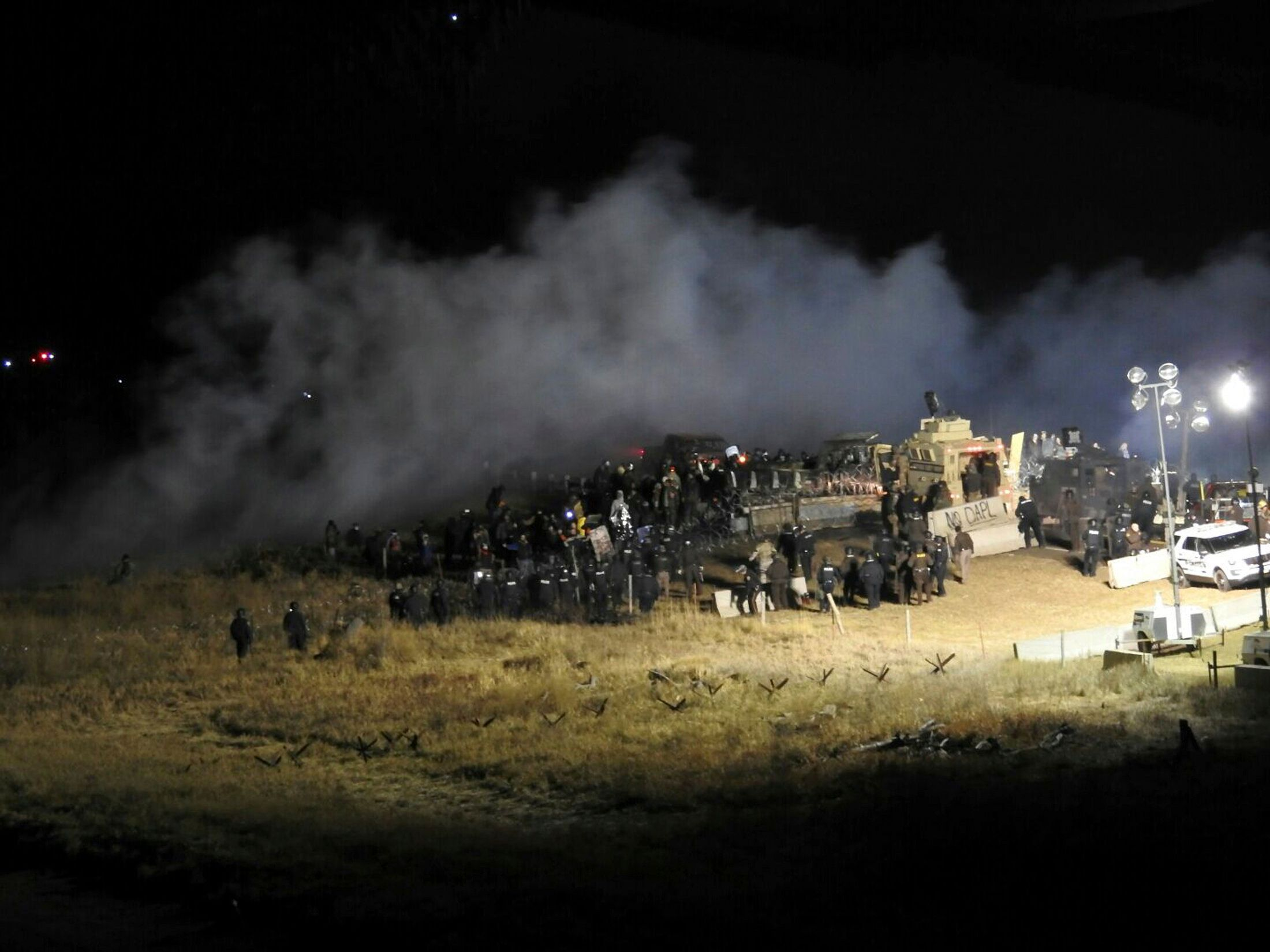 Law enforcement officers surrounded demonstrators protesting the Dakota Access pipeline in North Dakota on Sunday night.