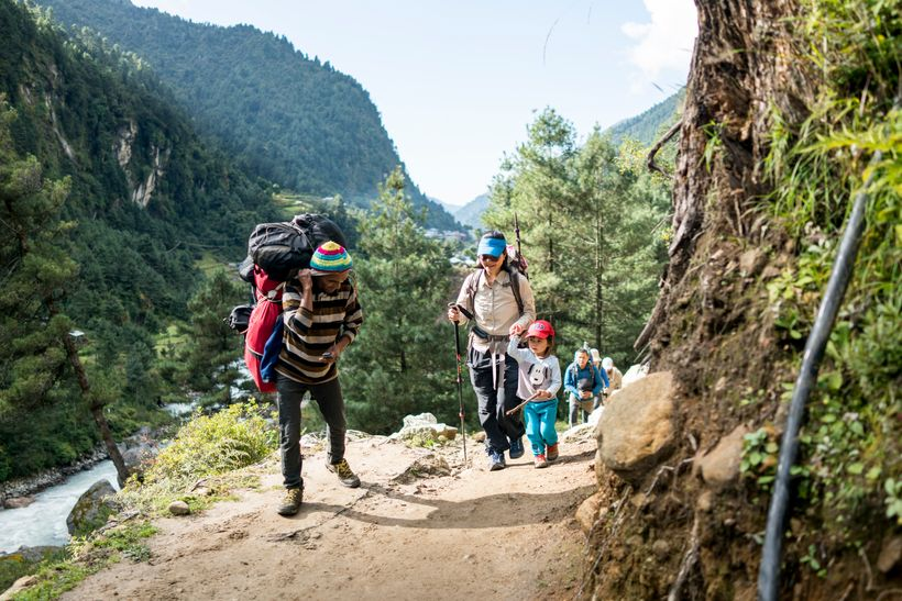 <em>A porter greets Little Chow on the trek towards Namche Bazaar, at an altitude of10,000ft..</em>