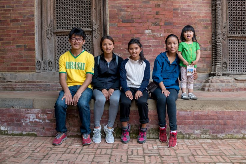 <em>Little Chow with the Sherpa children. Kama (third from left) was the same age as Little Chow when I last sawher.</em>