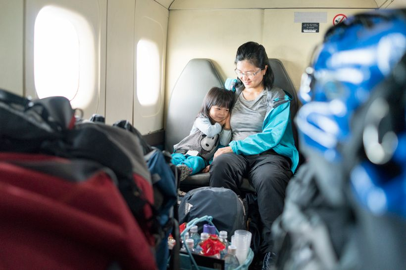 <em>On a propeller plane between Lukla and Kathmandu. Yes, the luggage is literally stacked like this.</em>