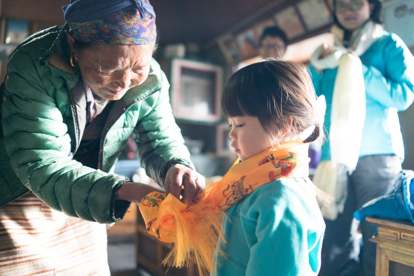 <em>Lakpa Diki, 60 puts on a kata for Little Chow as a Sherpa custom of blessing for a safe passage home.  Little Chow have e