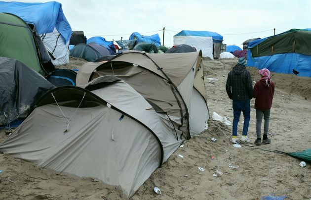 Two orphaned refugees in the Calais camp, before its