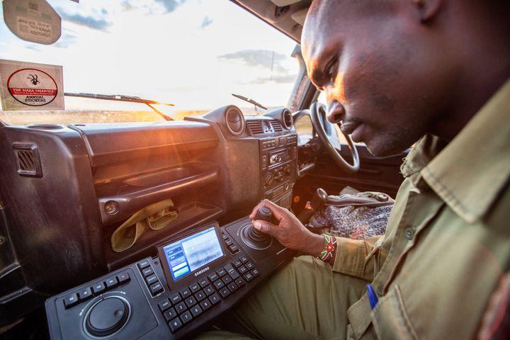 A ranger tests the FLIR thermal imaging camera in the Maasai Mara game reserve.