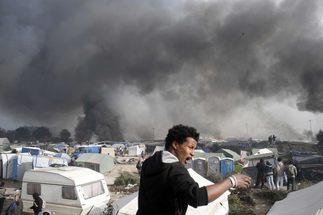 The Calais camp burns during the eviction on October