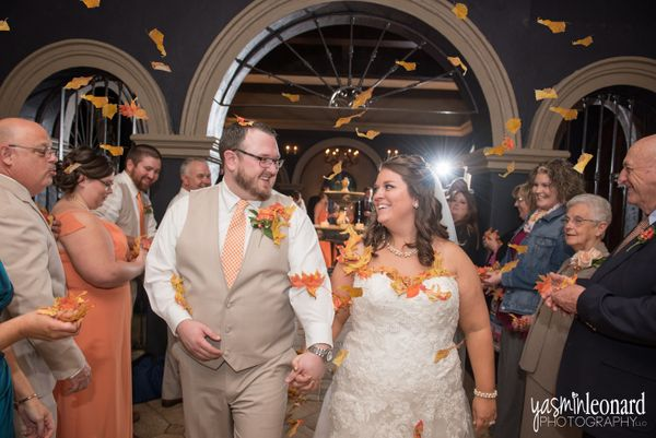 """""""Tyler and Jessica's grand exit perfectly concluded their fall-themed wedding at the Lofts at Union Square in High Point, N.C"""