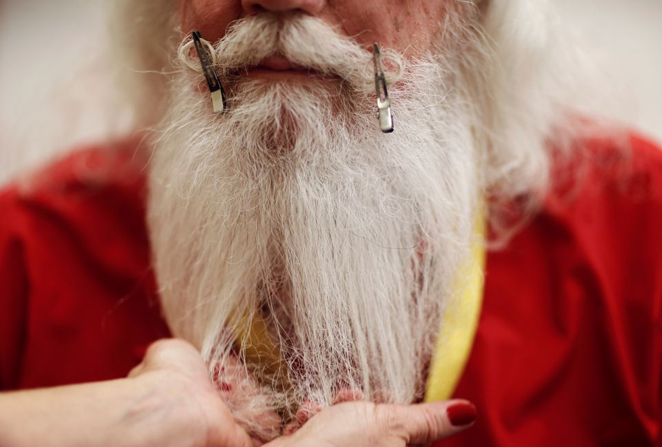 Santa Lamar May of Dallas, Georgia is shown how to groom his beard and moustache during classes at the Charles W. Howard Sant