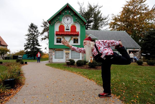 Santa Jerry Julian of Colorado Springs, Colorado shows some yoga moves outside the Santa House.