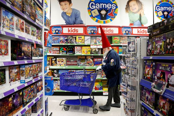 Santa Fred Osther from Oslo, Norway shops at a Toys R Us.