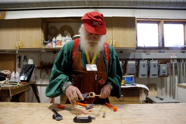 Santa Randy Schneider of Muskegon, Michigan learns wood toy making in the Gerace shop.