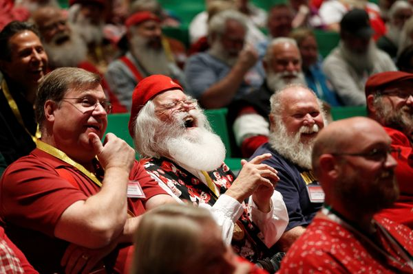 Santas laugh as they learn about Santa Spirit.
