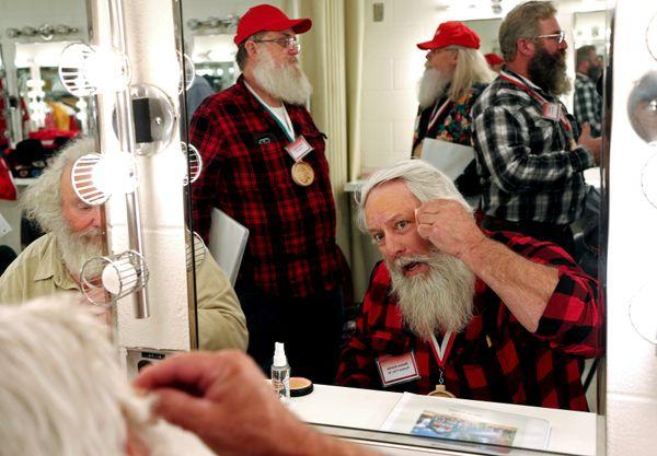 Santa Holmes Kimble from Farmer City, Illinois, learns to apply Santa make-up.