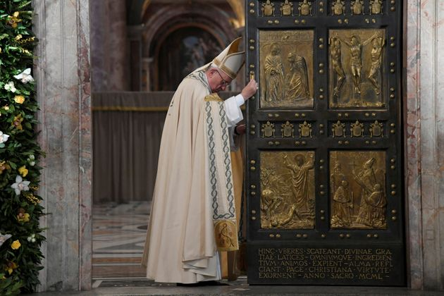 Pope Francis closes the Holy Door to mark the closing of the Catholic Jubilee year of mercy at the in...