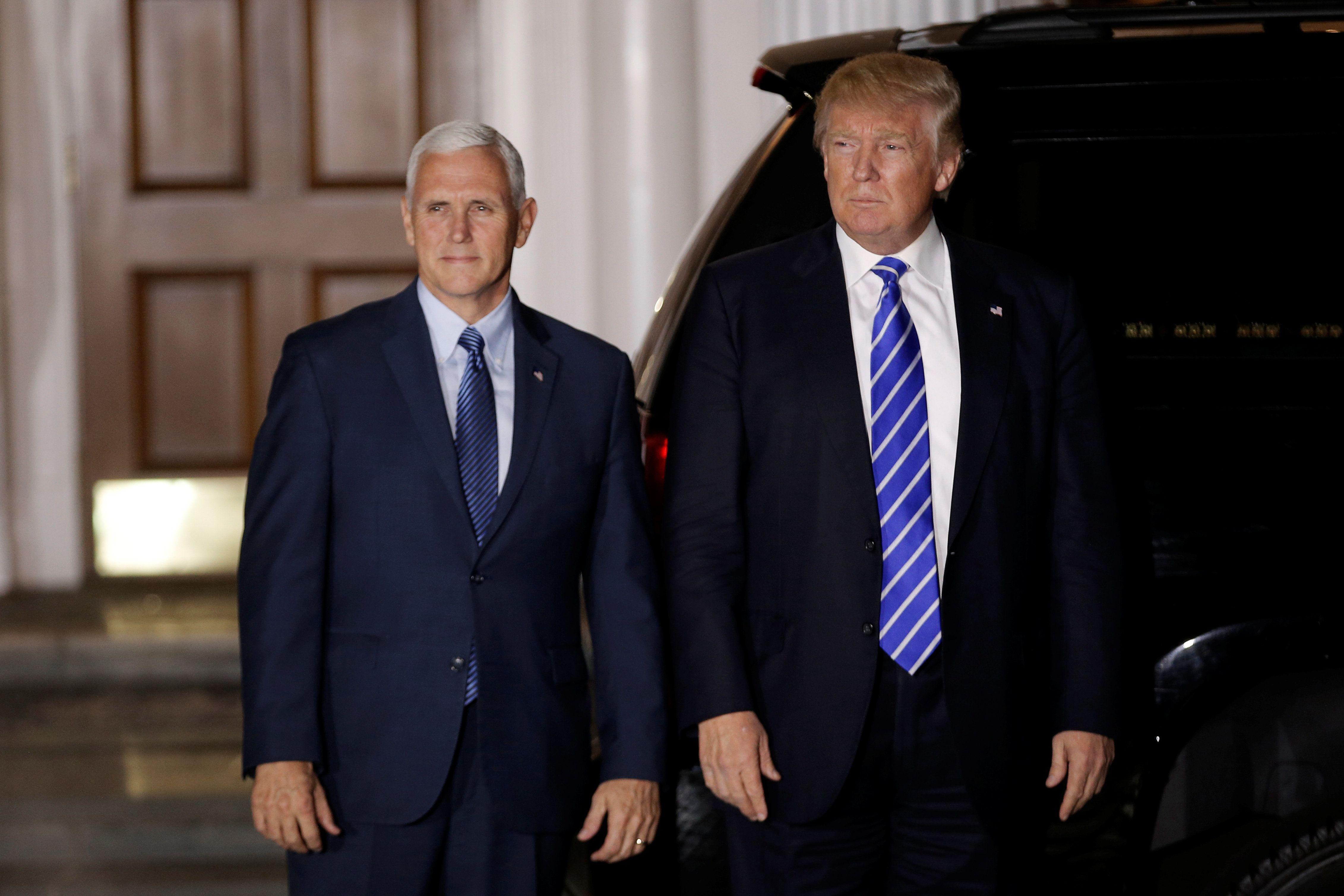 U.S. President-elect Donald Trump and Vice President-elect Mike Pence depart the main clubhouse at Trump National Golf Club i