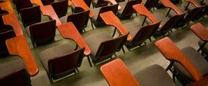 CLASSROOM EDUCATION EMPTY LEARNING LECTURE HALL NOBODY SCHOOL UNIVERSITY COLLEGE DESKS HIGHANGLE VIEW INDOOR PATTERN ROWS SEATING SEATS