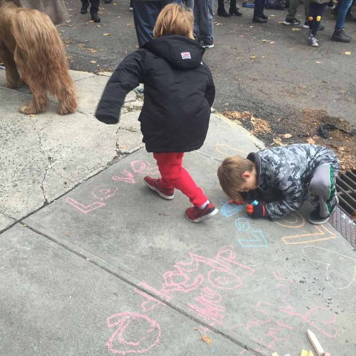 "Chrystin Ondersma's 7-year-old son and his friend attended the anti-hate rally at Adam Yauch Park and wrote messages on the sidewalk like ""peace"" and ""hate is bad."""