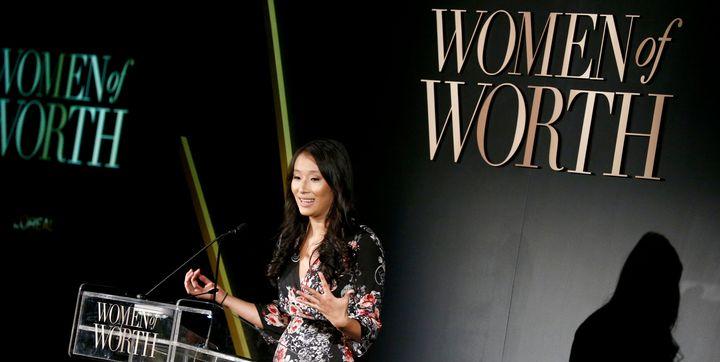 Okamoto speaks on stage at the L'Oreal Paris Women of Worth Celebration on Nov. 16, 2016.