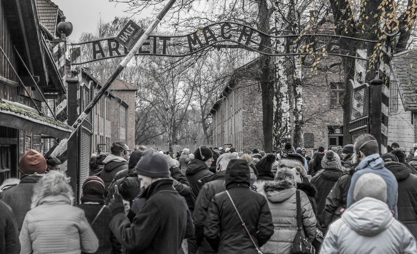 "The infamous ""Arbeit Macht Frei (Work Makes You Free)"" sign at entry gate at Auschwitz"