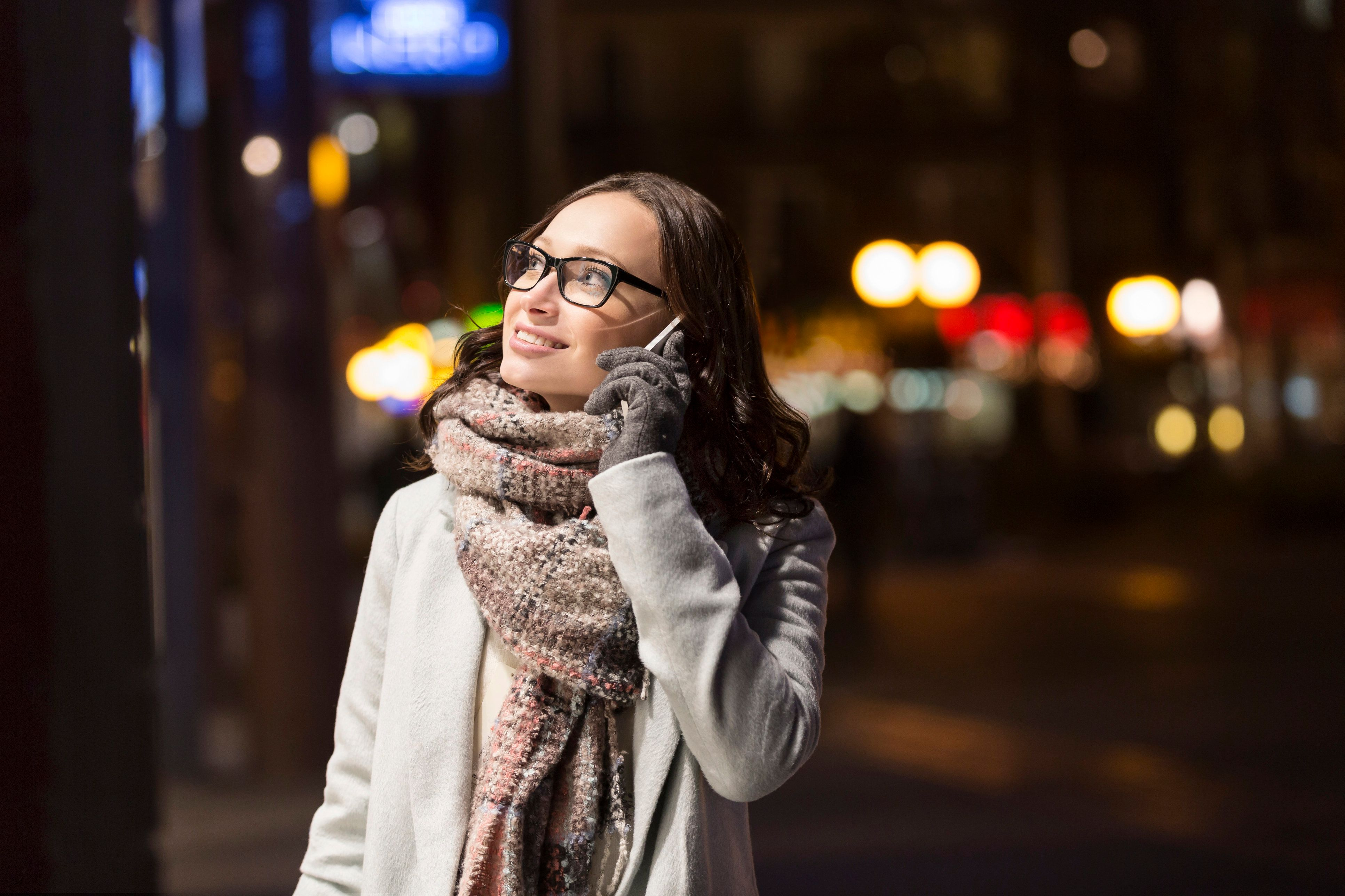 Young woman on shopping tour by night