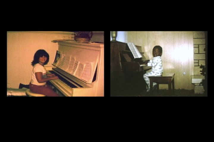 <p>A Small World, 1999-2001, Sanford Biggers and Jennifer Zackin. Single-channel projection (color, silent) DVD, carpet, sofa, wood panel walls.</p>