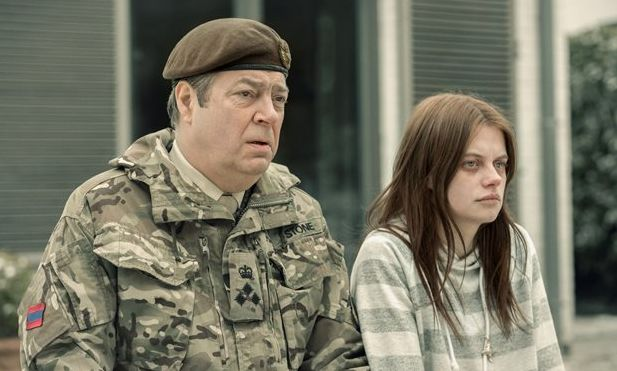 Brigadier Stone (Roger Allam) has a mysterious conversation with returned girl Alice Webster (Abigail