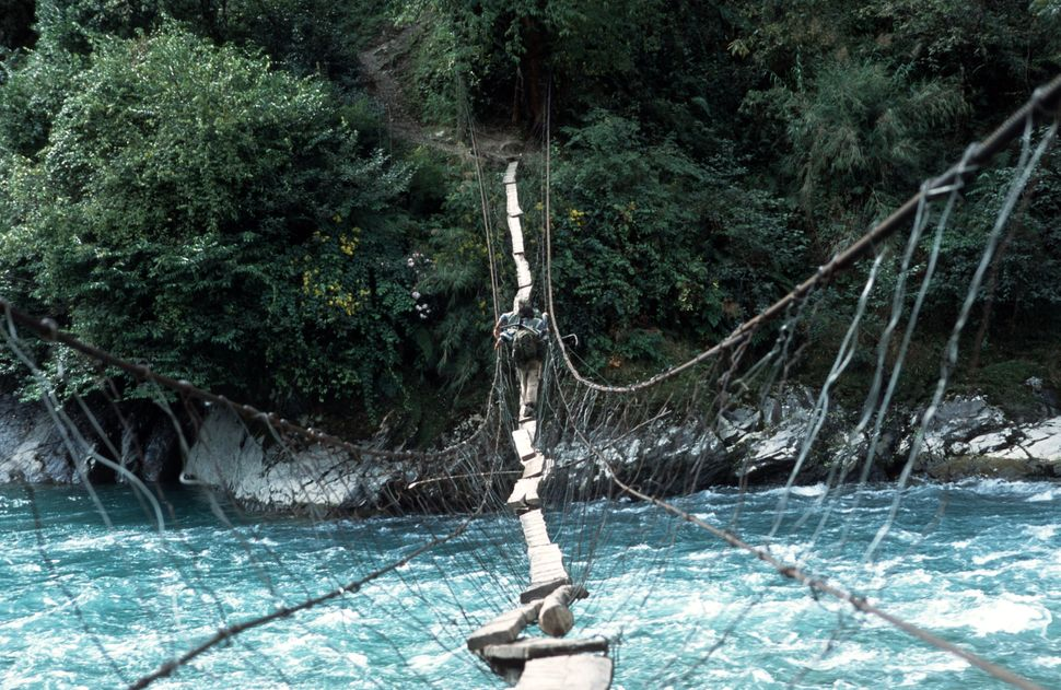 A precarious crossing between villages in the Dulong Valley, China.