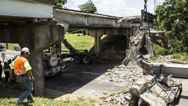 Texas transportation workers in July survey the damage from a bridge collapse in which a child died. President-elect Donald T