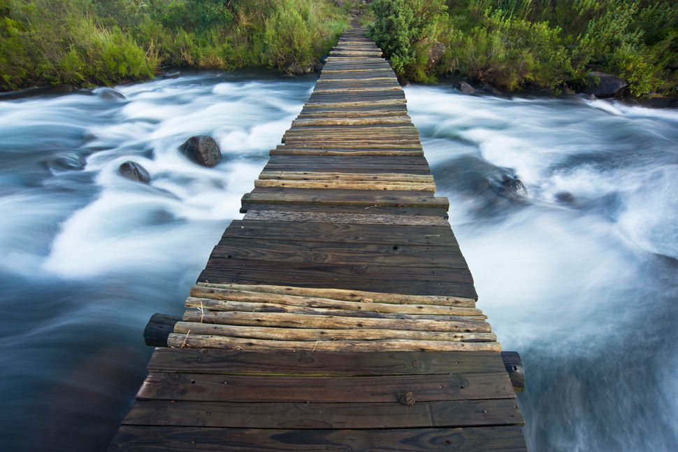 Footbridge over Del'mhlwazini River in Njesuthi portion of Drakensberg, Kwazulu Natal province, South Africa.