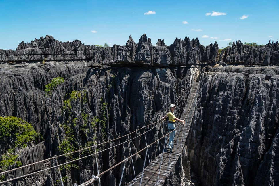 A woman on a suspension bridge in the National Park Tsingy du Bemaraha, Mahajanga, Madagascar.