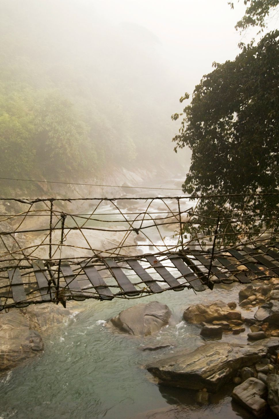 Footbridge in Northern Hilltribe trekking city of Moung Mon on the border of China (Sapa Region).