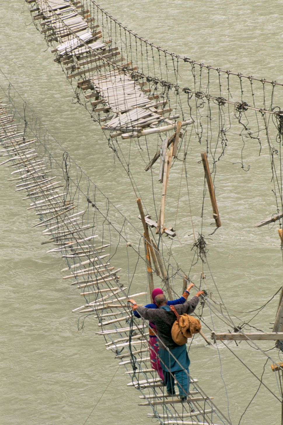 Swinging bridges near Passu, Bojal, Pakistan.