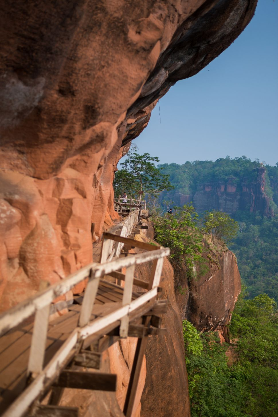 Wooden bridge in red cliffside at Wat Phu Tok mountain in Bueng Kan, Thailand.
