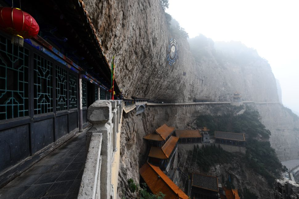 Mianshan scenic area in China consists of a series of temples (mainly Taoist) constructed on these cliffs over time.