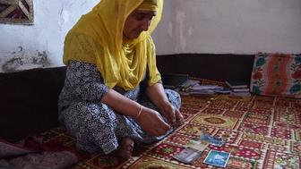 Shameema Jan goes through old photos of her husband a Kashmiri rebel who was killed by the Indian army Like many widows of militants who have died during the 30year counterinsurgency campaign Jan has little support from the government or her community