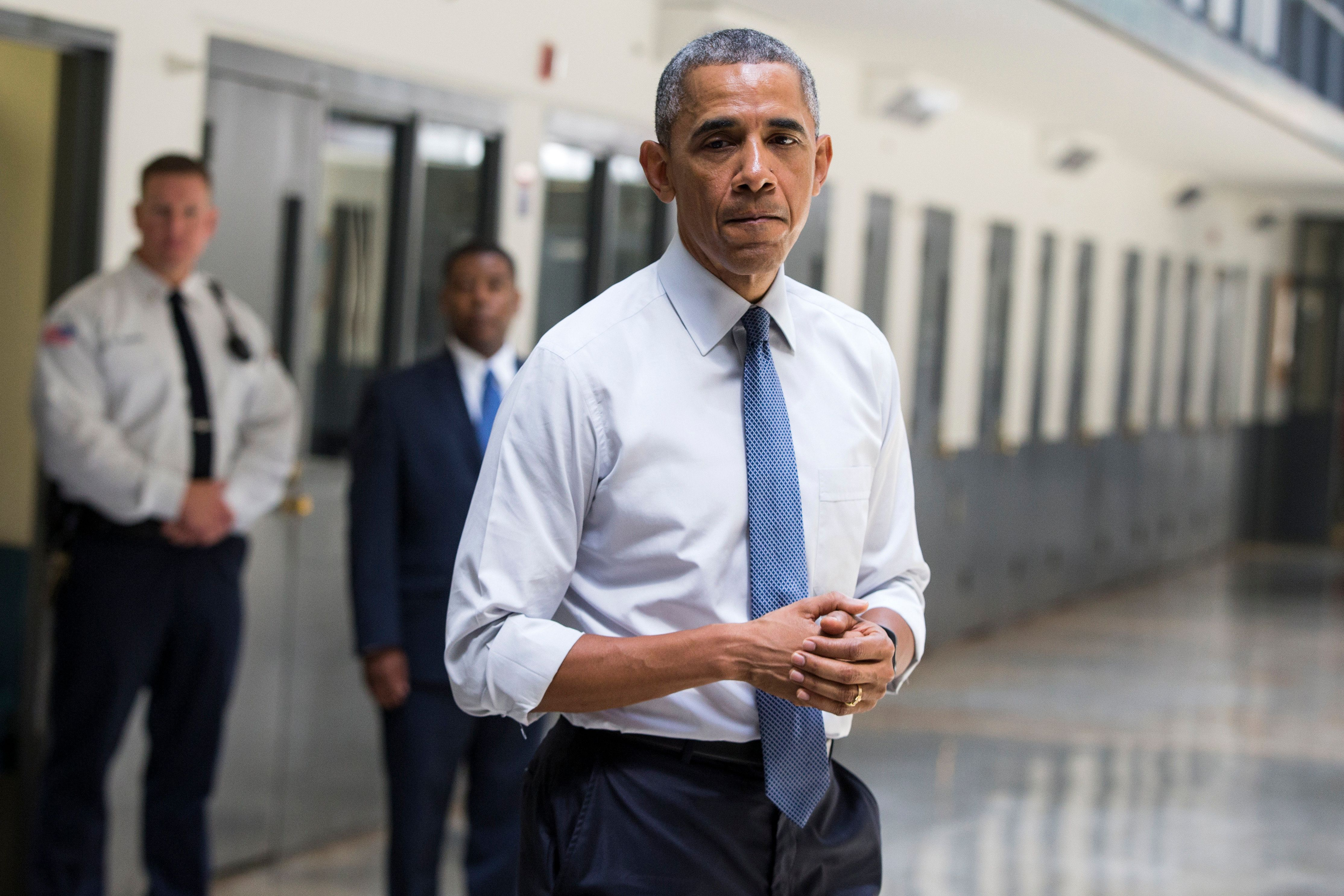 """FILE - In this July 16, 2015 file photo, President Barack Obama pauses as he speaks at the El Reno Federal Correctional Institution in El Reno, Okla. An HBO documentary, """"Fixing the System"""", that features President Obama's historic visit to the prison, and his in-depth conversations with six of the inmates will be premiered Wednesday, Sept. 23, 2015, at the prison before about 100 inmates. (AP Photo/Evan Vucci, file)"""