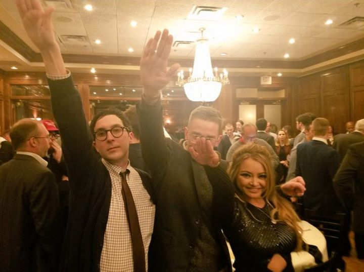 Tila Tequila poses with two others while performing the Nazi salute.
