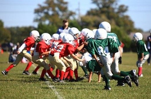 Youth football players playing a game at Camp Lejeune, NC.