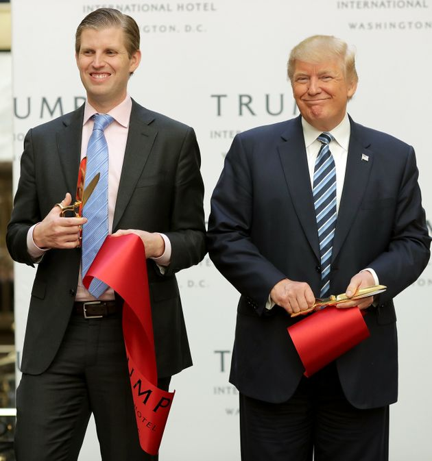 President-elect Donald Trump (right) and his adult son Eric Trump (left) cut the ribbon to open the Trump...