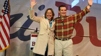 Texas state Senate candidate Konni Burton, left, and U.S. Sen. Ted Cruz (R-Texas) wave to supporters during the Take Back SD 10 Rally in Fort Worth, Texas, on Wednesday, March 19, 2014. (Ron T. Ennis/Fort Worth Star-Telegram/MCT via Getty Images)