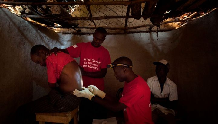 Doctors Without Borders staff perform a spinal tap in the village of Basoloy, region of Doromo, northeastern DRC.