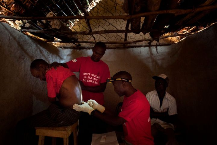 Doctors Without Bordersstaff perform a spinal tap in the village of Basoloy, region of Doromo, northeastern DRC.