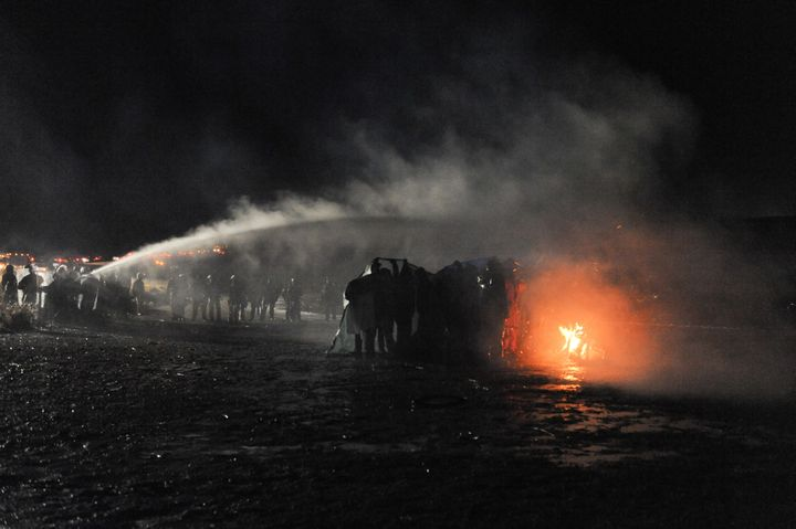 Law enforcement officers use a water cannon amid protests against the Dakota Access Pipeline.