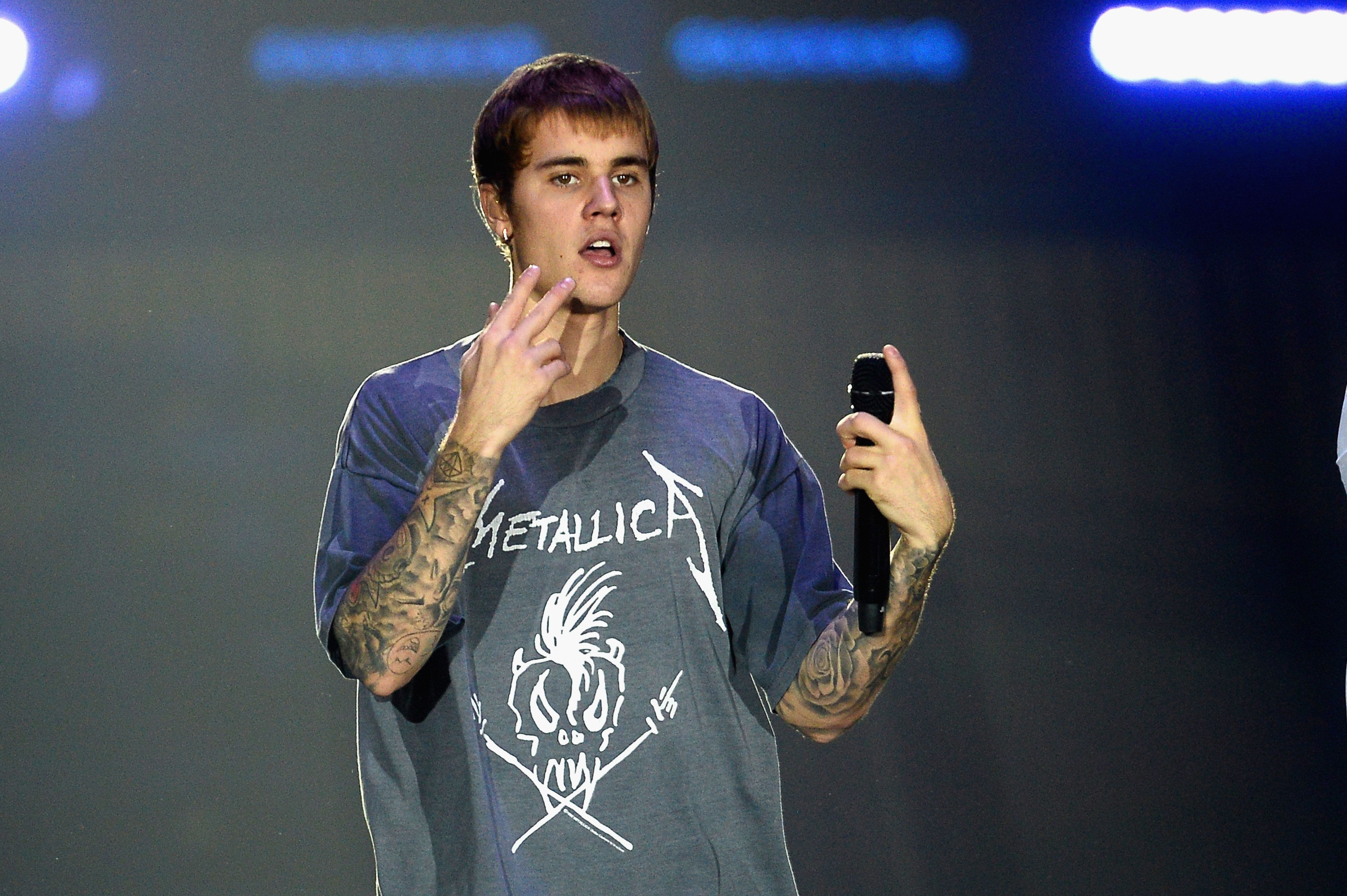 Justin Bieber Appears To Punch Fan Who Leaned Into His Car In The