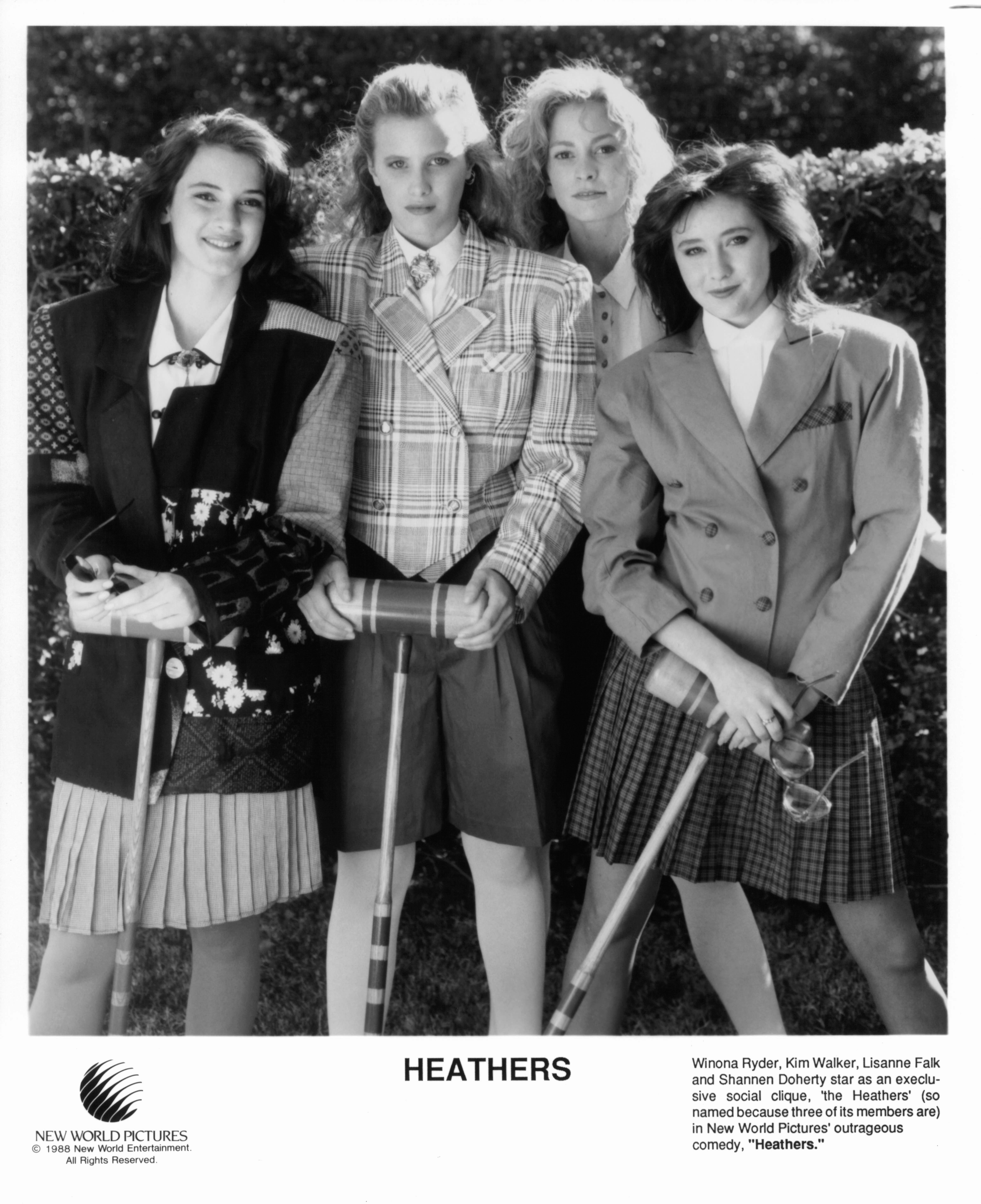 Winona Ryder, Kim Walker, Lisanne Falk, and Shannen Doherty are members of an exclusive social clique in a scene from the film 'Heathers', 1988. (Photo by New World Pictures/Getty Images)