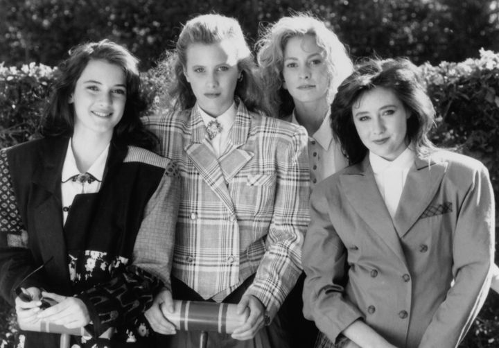 """Winona Ryder, Kim Walker, Lisanne Falk, and Shannen Doherty are members of an exclusive social clique in 1988's """"Heathers."""""""