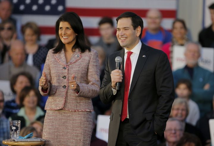 Marco Rubio smiles as he speaks while South Carolina Governor Nikki Haley gives a thumbs up during a campaign event in Chapin