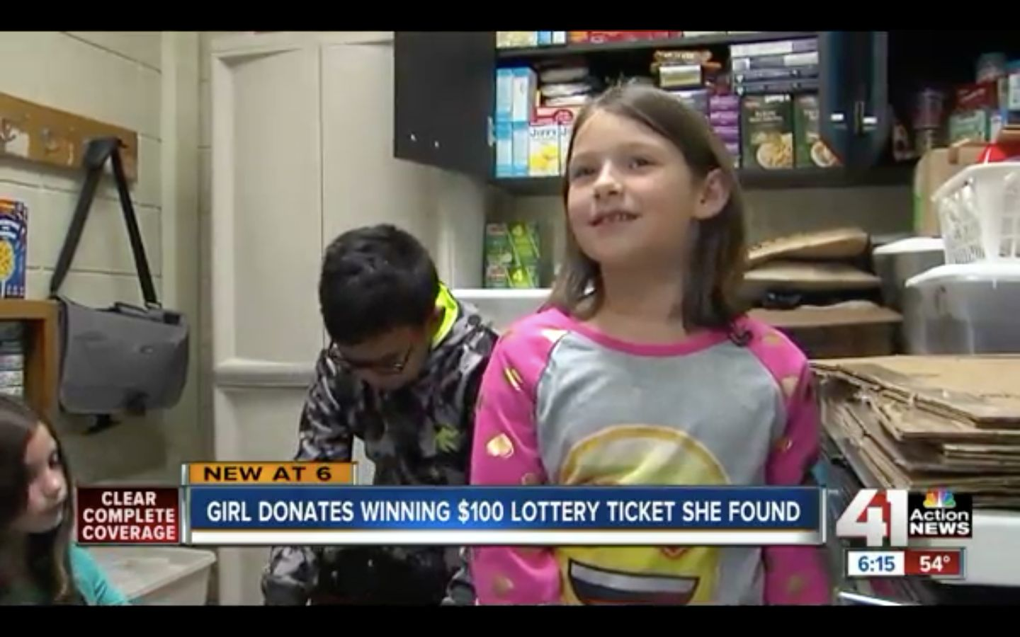 Phoebe Brown, 7, donated $100 worth of food to her school's food drive after finding a winning scratch-off ticket on the grou
