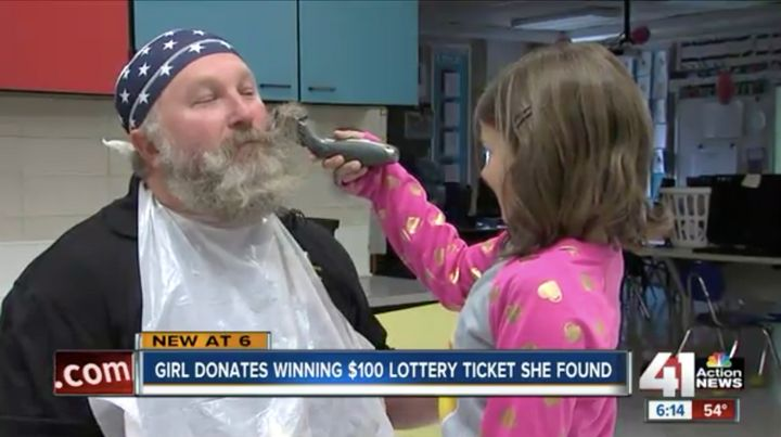 The second-grader got the first shot at helping shave her gym teacher's beard as a fun prize for winning her school's food drive.