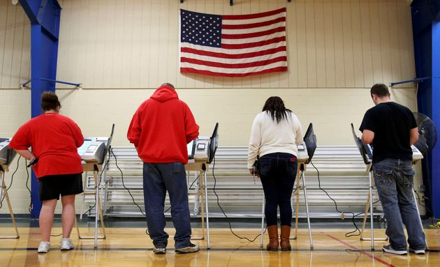 Voters cast their votes during the U.S. presidential election in Elyria, Ohio, U.S. November 8,